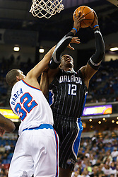 March 9, 2011; Sacramento, CA, USA;  Orlando Magic center Dwight Howard (12) shoots past Sacramento Kings shooting guard Francisco Garcia (32) during the first quarter at the Power Balance Pavilion.