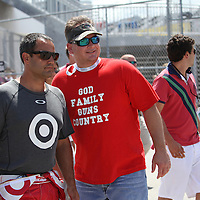 NASCAR Sprint Cup driver Juan Pablo Montoya (42) is seen posing with a fan in the garage area during the NASCAR Coke Zero 400 Sprint practice session at the Daytona International Speedway on Thursday, July 4, 2013 in Daytona Beach, Florida.  (AP Photo/Alex Menendez)