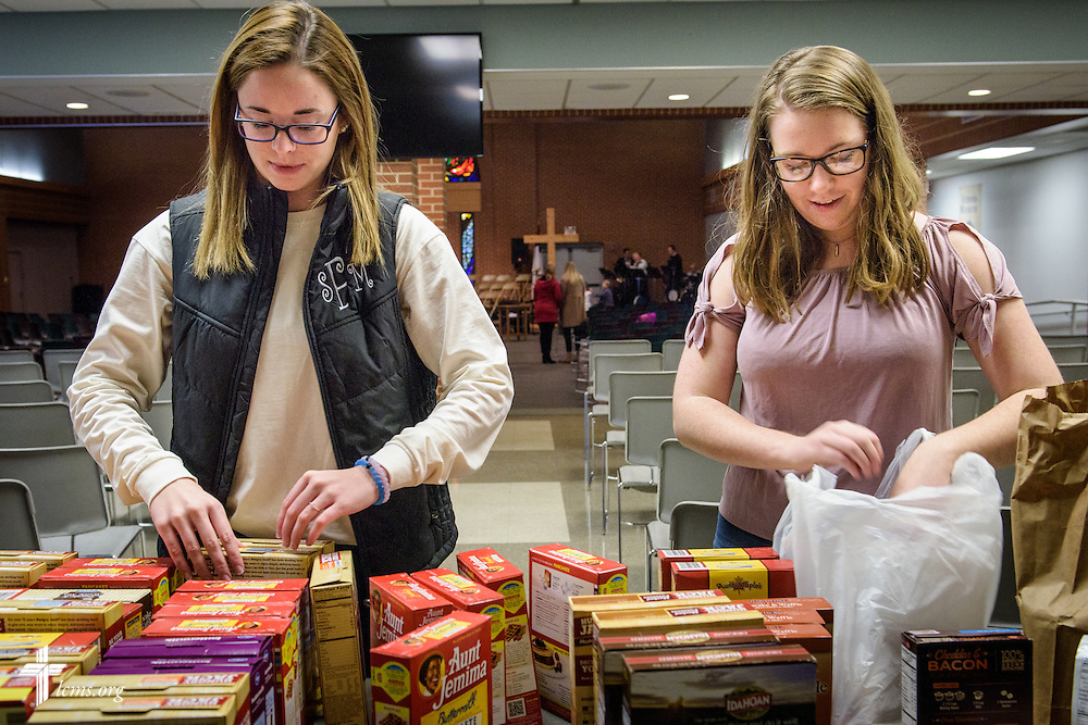 Sarah Franklin (left) and Isabella Schneider pack food pantry items for delivery on Sunday, Feb. 26, 2017, at Immanuel Lutheran Church & School in St. Charles, Mo. LCMS Communications/Erik M. Lunsford