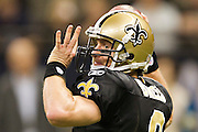 NEW ORLEANS, LA - DECEMBER 26:   Quarterback Drew Brees #9 of the New Orleans Saints warms up before a game against the Atlanta Falcons at Mercedes-Benz Superdome on December 26, 2011 in New Orleans, Louisiana.  The Saints defeated the Falcons 45-16.  (Photo by Wesley Hitt/Getty Images) *** Local Caption *** Drew Brees