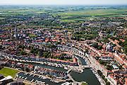 Nederland, Zeeland, Middelburg, 12-06-2009; Overzicht oostelijk deel van het centrum van de middeleeuwse stad, beschermde stadsgezicht. Links de toren de Lange Jan, behorende bij de Abdij, en rechts aan de rand van de stad de Oostkerk, rechts de Oostkerk. Het water van de Rotterdamse Kaai met De Punt in de voorgrond. In de achtergrond Walcheren gezien naar de Oosterschelde..Center of the medieval city, left the historic town hall, in the middle the former Abbey with the 89 meter high tower.Swart collectie, luchtfoto (25 procent toeslag); Swart Collection, aerial photo (additional fee required).foto Siebe Swart / photo Siebe Swart