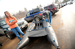 "Julie Smith of Nashua watches as her kayaking partner Richard Chaney checks their inflatable twin hulled ""Shredder"" kayak at the ""put in"" area of the 30th annual New Year's Day kayak event in Franklin on Saturday, January 1, 2011.  (Alan MacRae/for the Monitor)"