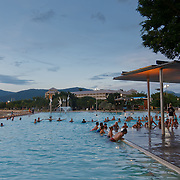 Cairns Esplanade is Cairns CBD. The esplanade lagoon, a saltwater swimming pool. People doing sport.
