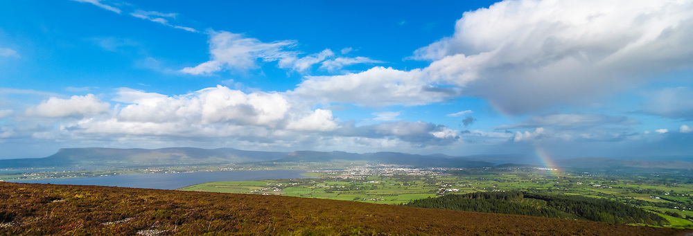 One of my very first panoramas taken on my compact camera from somewhere I've been returning to again and again ever since - Knocknarea Mountain near Sligo Town. On this particular day it was showering with rain on and off, producing quite a few rainbows and I was lucky enough that this one came up over Sligo Town when I was at the top :)