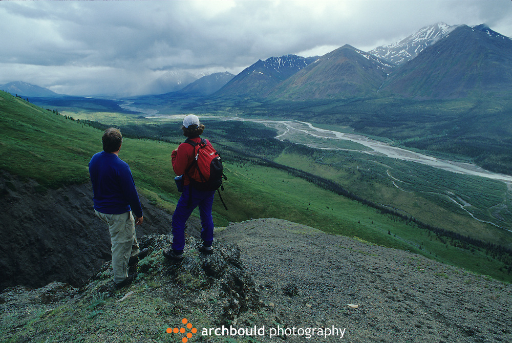 Hikers look over the valley of the Snake River, Yukon