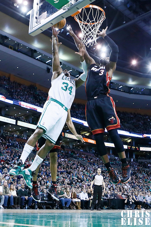 27 January 2013: Boston Celtics small forward Paul Pierce (34) goes for the layup against Miami Heat shooting guard Dwyane Wade (3) during the Boston Celtics 100-98  2OT victory over the Miami Heat at the TD Garden, Boston, Massachusetts, USA.