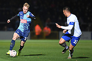 Wycombe Wanderers defender Jack Grimmer (19) sprints forward with the ball  under pressure from Tranmere Rovers defender (on loan from West Bromwich Albion) Kane Wilson (22) during the The FA Cup match between Wycombe Wanderers and Tranmere Rovers at Adams Park, High Wycombe, England on 20 November 2019.