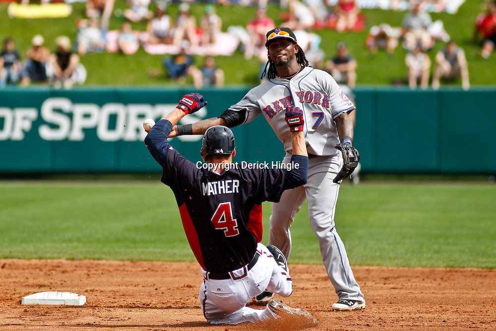 March 5, 2011; Lake Buena Vista, FL, USA; New York Mets shortstop Jose Reyes (7) forces out Atlanta Braves outfielder Joe Mather (4) and throws to complete a double play during a spring training exhibition game at Disney Wide World of Sports complex. Mandatory Credit: Derick E. Hingle-US PRESSWIRE