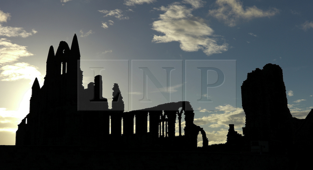© Licensed to London News Pictures. <br /> 01/11/2014. <br /> <br /> Whitby, Yorkshire, United Kingdom<br /> <br /> The runs of Whitby Abbey at first light during the Whitby Goth Weekend. <br /> <br /> The event this weekend brings together thousands of extravagantly dressed followers of Victoriana, Steampunk, Cybergoth and Romanticism who all visit the town to take part in celebrating Gothic culture. This weekend marks the 20th anniversary since the event was started by local woman Jo Hampshire.<br /> <br /> Photo credit : Ian Forsyth/LNP