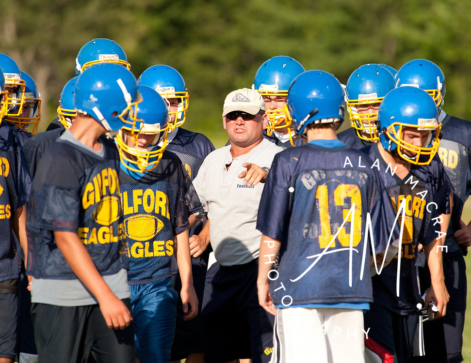 Gilford head football coach Mark Brewer directs his team during practice on Wednesday, August 11, 2010.  (Alan MacRae/for the Citizen)