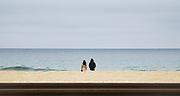 A couple watch the sea at Jeongdongjin beach in Gangneung, 168 km east of Seoul, South Korea. Photo by Lee Jae-Won (SOUTH KOREA) www.leejaewonpix.com