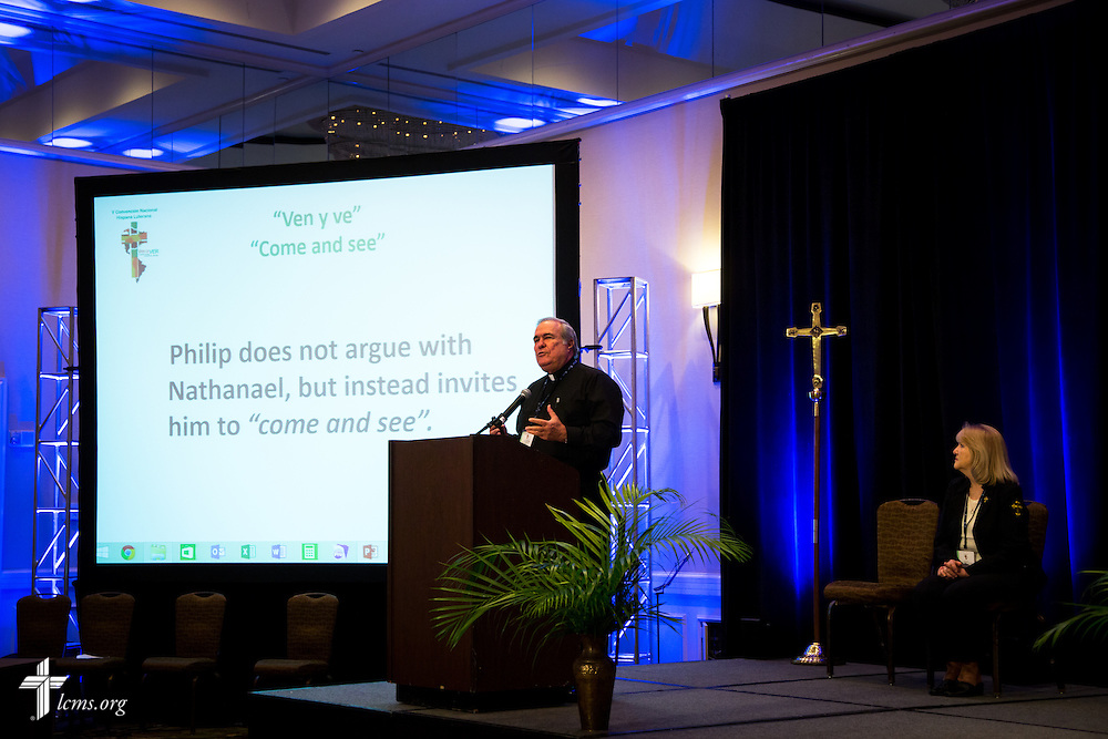 "The Rev. Benito Perez, pastor of Hospital del Alma Lutheran Church in Leisure City, Fla., speaks on Wednesday, July 29, 2015, during the 5th Hispanic National Convention, ""¡Come and See!: Celebrating Our Gifts,"" at the Grand Hyatt Tampa Bay in Tampa, Fla. He is joined on stage by Deaconess Jessie Perez. LCMS Communications/Pamela Nielsen"