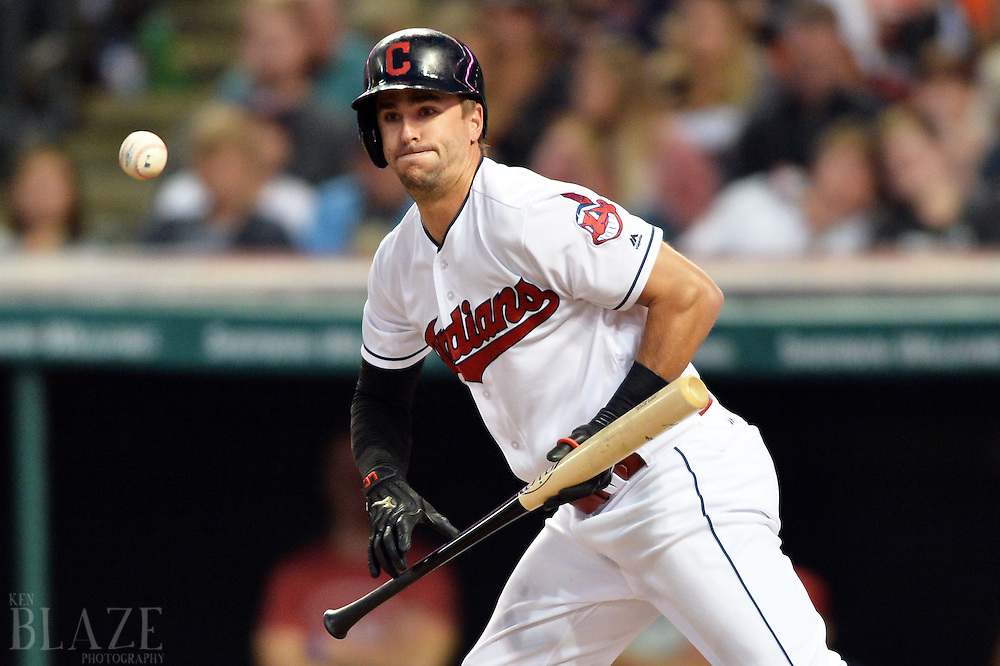 Sep 3, 2016; Cleveland, OH, USA; Cleveland Indians right fielder Lonnie Chisenhall (8) lays down a sacrifice bunt during the third inning against the Miami Marlins at Progressive Field. Mandatory Credit: Ken Blaze-USA TODAY Sports