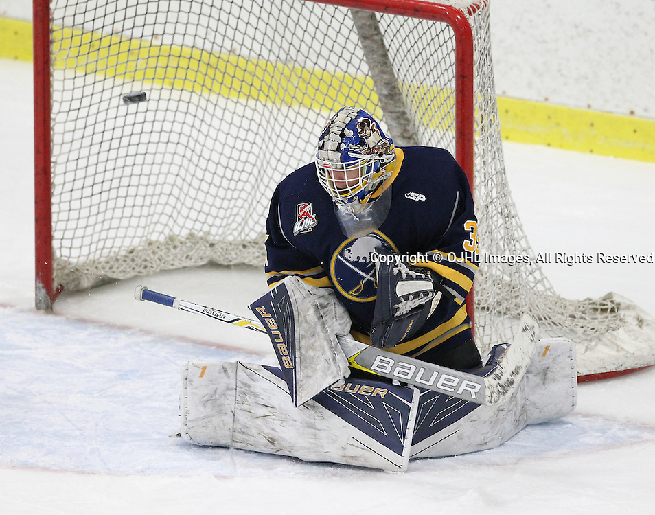 GEORGETOWN, ON  - MAR 2,  2017: Ontario Junior Hockey League, playoff game between the Georgetown Raiders and the Buffalo Jr Sabres. Alex Camarre #35 of the Buffalo Jr. Sabres gets set to blocks the shot during the first period.<br /> (Photo by Tim Bates / OJHL Images)