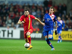 SWANSEA, WALES - Tuesday, March 26, 2013: Wales' Joe Ledley in action against Croatia during the 2014 FIFA World Cup Brazil Qualifying Group A match at the Liberty Stadium. (Pic by David Rawcliffe/Propaganda)