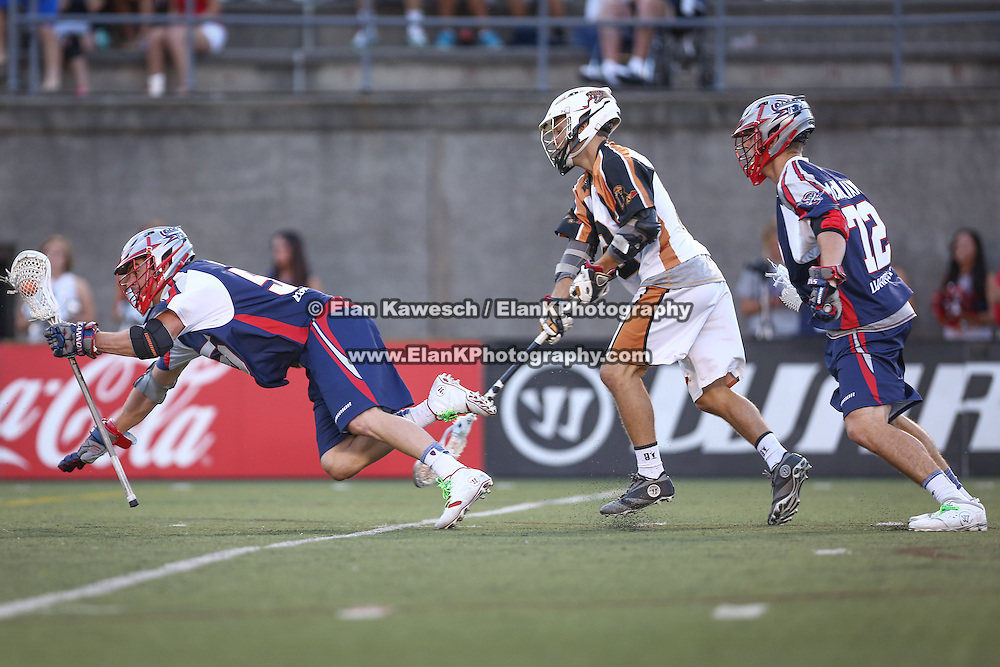 Eric Martin #55 of the Boston Cannons falls to the ground with the ball during the game at Harvard Stadium on August 9, 2014 in Boston, Massachusetts. (Photo by Elan Kawesch)