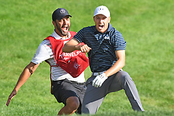 June 25, 2017 - Cromwell, Connecticut, U.S - PGA Tour Caddy Michael Greller and Jordan Spieth react to the winning shot during Travelers Championship at TPC River Highlands in Cromwell, Connecticut. (Credit Image: © Brian Ciancio via ZUMA Wire)