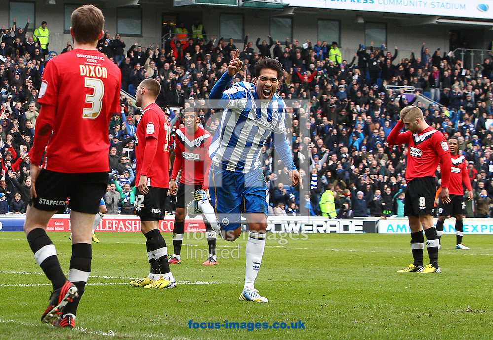 Picture by Paul Terry/Focus Images Ltd +44 7545 642257.02/03/2013.Leonardo Ulloa ( C ) of Brighton and Hove Albion celebrates after he scores the opening goal during the npower Championship match at the American Express Community Stadium, Brighton and Hove.