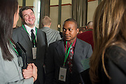 Rebecca Burlahardt, left, Eric Mielcusny, left center, Michael Rodgers, center, and Lauren Fozard, right, mingle at the Ohio University Sports Administration Career Fair at Walter Hall Rotunda. Photo By Elizabeth Held