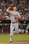 PHOENIX, AZ - JULY 08:  Scooter Gennett #4 of the Cincinnati Reds points upward after hitting a solo home run against the Arizona Diamondbacks during the fifth inning at Chase Field on July 8, 2017 in Phoenix, Arizona.  (Photo by Jennifer Stewart/Getty Images)