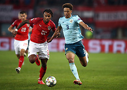 Austria's Valentino Lazaro (left) and Northern Ireland's Jamal Lewis battle for the ball during the UEFA Nations League match at the Ernst Happel Stadium, Vienna.