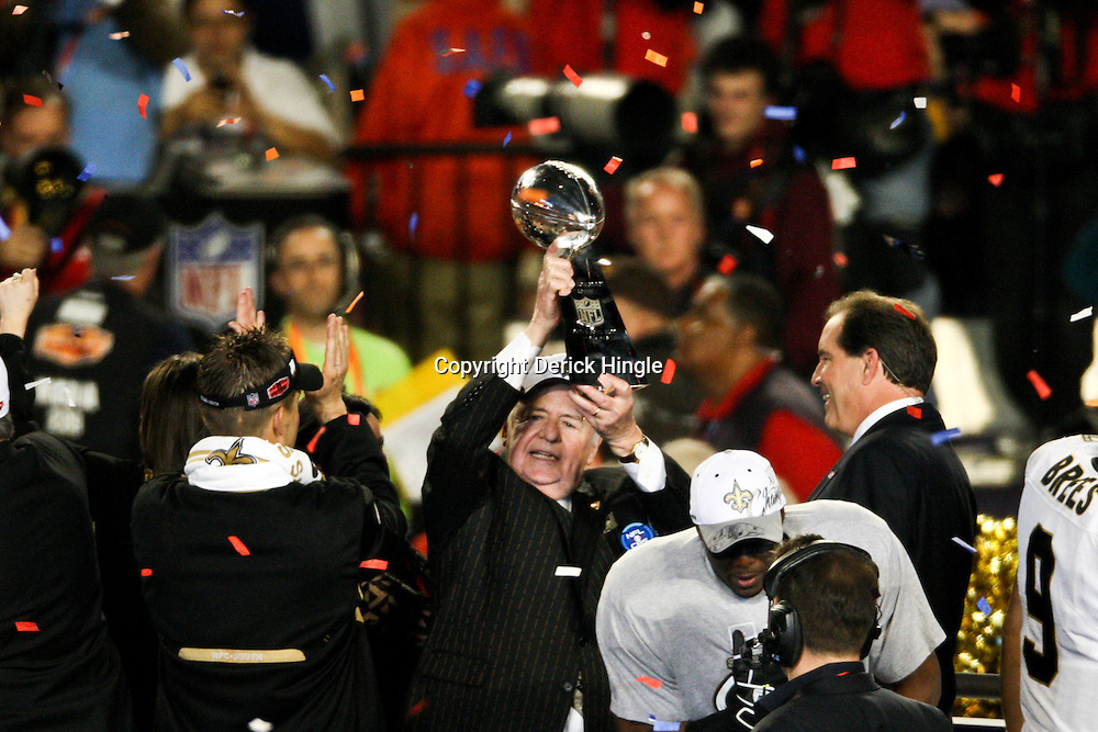 2010 February 07: New Orleans Saints owner Tom Benson celebrates with the Vince Lombardi Trophy following a 31-17 win by the New Orleans Saints over the Indianapolis Colts in Super Bowl XLIV at Sun Life Stadium in Miami, Florida.