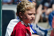 BAR HARBOR, MAINE, July 4, 2014. A young rider in the Independence Day Parade.