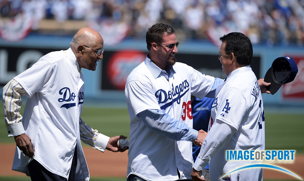 Apr 6, 2015; Los Angeles, CA, USA; Don Newcombe (left), Eric Gagne (center) and Fernando Valenzuela react after throwing out the ceremonial first pitch before the 2015 MLB opening day game between the San Diego Padres and the Los Angeles Dodgers at Dodger Stadium.