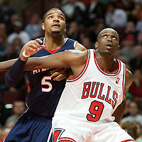 19 December 2009: Atlanta Hawks forward Josh Smith vies with Chicago Bulls forward Luol Deng during the Chicago Bulls 101-98 victory in overtime over the Atlanta Hawks at the United Center, in Chicago, Illinois, USA.