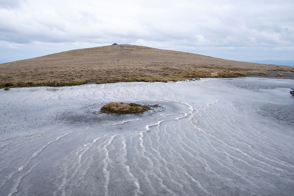 Frozen ripples in a small glacial lake below Doddick Fell near the summit of Blencathra Mountain, Lake District, Cumbria, UK. The temperature is so cold and the strong wind caused the water to freeze in wave formations.  (photo by Andrew Aitchison / In pictures via Getty Images)