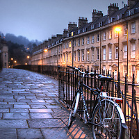Winter street scene in Bath, Somerset, England with bicycle on pavement
