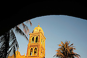 Loreto, Mexico Spanish mision belll towner with arch.