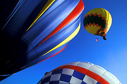 Stock photo of three hot air balloons in air at the Ballunar Liftoff Festival in Houston Texas