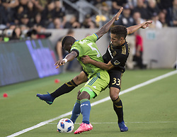 April 29, 2018 - Los Angeles, California, U.S - 29 April 2018, Los Angeles, Ca.,The Los Angeles Football Club (LAFC) beat the Seattle Sounders in the inaugural game at the new Banc of California Stadium. Pictured is Sounders' Nouhou defended by LAFC's Benny Feilhaber. (Credit Image: © Prensa Internacional via ZUMA Wire)