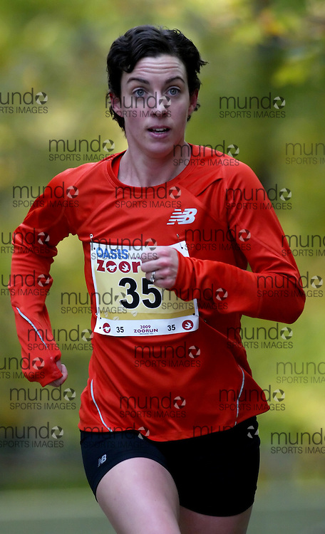 "(Toronto, Ontario -- 17 Oct 2009) MEGAN METCALFE works hard to race up the long boardwalk hill by the tiger enclosure in the 2009 OASIS Zoo Run 10K run and Athletics Canada national 10 km road racing championship at the Toronto Zoo. [Photo credit should read ""Sean Burges / Mundo Sport Images""]"