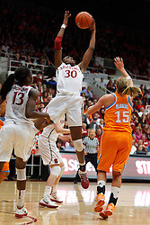 Dec 20, 2011; Stanford CA, USA;  Stanford Cardinal forward Nnemkadi Ogwumike (30) grabs a rebound in front of Tennessee Lady Volunteers forward Alicia Manning (15) during the first half at Maples Pavilion.  Stanford defeated Tennessee 97-80. Mandatory Credit: Jason O. Watson-US PRESSWIRE
