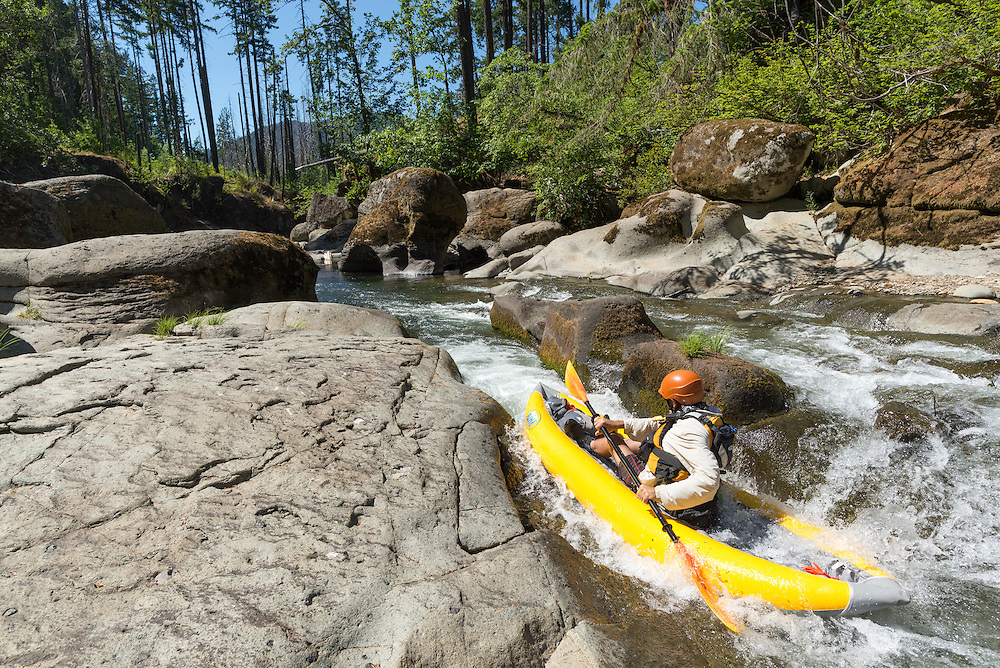 Paddling through a narrow shoot on Fall Creek, Oregon.