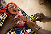 A child receives an oral polio vaccination at the Adja-Ouere community health center in the village of Adja-Ouere, Benin on Friday September 14, 2007.