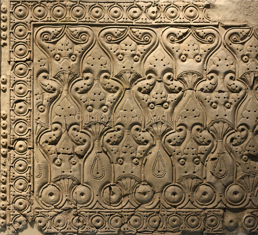 Wall paper made from stucco : interiors from houses and palaces. Particularly famous for Samarra is its carved stucco, with once decorated the dadoes of houses and palaces. There are three different styles. Two styles show vine leaves, grapes and leaf tendrils closely follow the tradition of Late Antiquity. There is then the flat cut 'bevelled' or 'slant' style of carving with stylised ornaments repeated in endless series. This was a ground-breaking invention and widely used in the Abbasid Empire in the 9th and 10th century.