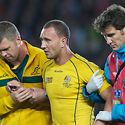 Quade Cooper, Australia, leaves the field after injuring his knee during the Australia V Wales Bronze Final match at the IRB Rugby World Cup tournament, Auckland, New Zealand. 21st October 2011. Photo Tim Clayton...