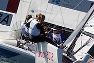 ENGLAND, Weymouth. 29th July 2012. Olympic Games. Elliott 6m, Women's match racing. France vs Australia. Claire Leroy (FRA) Skipper, Elodie Bertrand (FRA) Crew, Marie Riou (FRA) Crew. Olivia Price (AUS) Skipper, Nina Curtis (AUS) Crew, Lucinda Whitty (AUS) Crew.