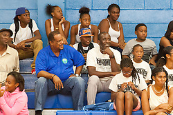 "Milt Newton watches ""Jah Souljahs"" take on the ""Roaring Lions""  during the first game of the Summer Classic.  Milton M. Newton Summer Classic Basketball Single Elimination 13-16 CoEd Tournament at the Charlotte Amalie High School Gymnasium.  St. Thomas, USVI.  8 August 2016.  © Aisha-Zakiya Boyd"