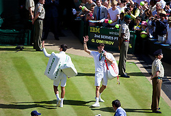 LONDON, ENGLAND - Friday, July 4, 2014: Novak Djokovic (SRB) and Grigor Dimitrov (BUL) wave to the crowd after the Gentlemen's Singles Semi-Final match on day eleven of the Wimbledon Lawn Tennis Championships at the All England Lawn Tennis and Croquet Club. (Pic by David Rawcliffe/Propaganda)