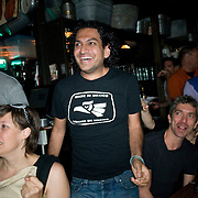 Date: 6/11/10..Some of the few Mexican fans in the room react to the first (and only) goal scored by Mexico during the 2010 World Cup opening Group A match between South Africa and Mexico at Madiba, a South African restaurant in Fort Greene, Brooklyn on June 11, 2010.   The game finished in a 1-1 tie. ..Photo by Angela Jimenez for Newsweek .photographer contact 917-586-0916/angelajime@gmail.com