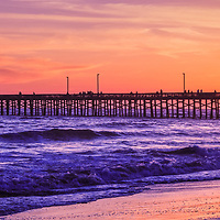 Newport Beach Pier sunset panorama photo. Panoramic image ratio is 1:3. Newport Pier is a popular attraction along the Pacific Ocean in Orange County Southern California.
