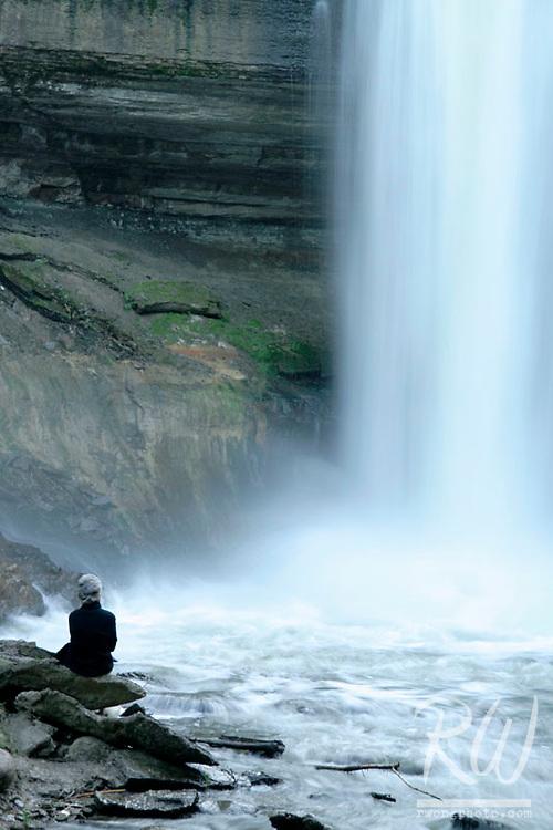 Woman Relaxing at Base of Minnehaha Falls, Minneapolis, Minnesota