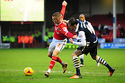 Jason Demetriou of Walsall FC holds off Edward Upson of Millwall FC during the Sky Bet League 1 match between Walsall and Millwall at the Banks's Stadium, Walsall, England on 6 February 2016. Photo by Mike Sheridan.