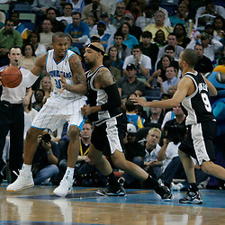 29 March 2009: New Orleans Hornets forward David West (30) is guarded by San Antonio Spurs center Drew Gooden (90) during a 90-86 victory by the New Orleans Hornets over Southwestern Division rivals the San Antonio Spurs at the New Orleans Arena in New Orleans, Louisiana.