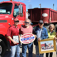 RAY VAN DUSEN/BUY AT PHOTOS.MONROECOUNTYJOURNAL.COM<br /> From left, Jon Michael Northington, Johnny and Wayne Northington, Shelia Rasbury and Jim Northington hold up pictures of their family on the yard of WEJ Trucking in Gattman. The trucking company, started as Ed Northington Trucking Co. in 1960, will culminate with a liquidation auction at the end of March.