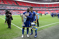 Adebayo Akinfenwa and Lyle Taylor of AFC Wimbledon celebrates winning the League Two Playoff Final with the Trophy - Mandatory by-line: Robbie Stephenson/JMP - 30/05/2016 - FOOTBALL - Wembley Stadium - London, England - AFC Wimbledon v Plymouth Argyle - Sky Bet League Two Play-off Final